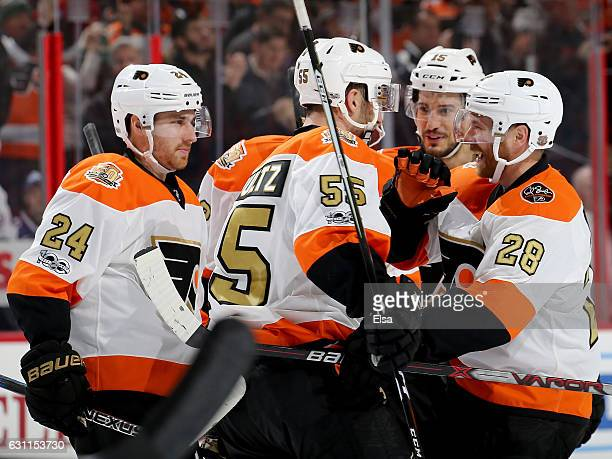 Matt Read,Nick Schultz,Michael Del Zotto and Claude Giroux of the Philadelphia Flyers celebrate Michael Raffl's goal in the second period against the...