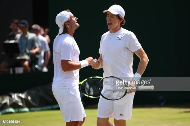 Matt Reid of Australia and JohnPatrick Smith of Australia celebrate during the Gentlemen's Doubles second round match against Nicholas Monroe of the...