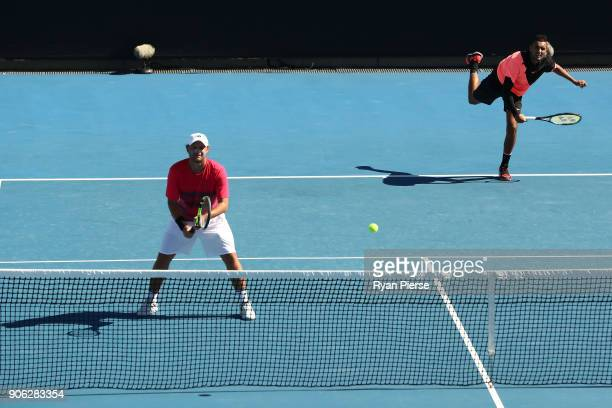 Matt Reid of Australia and Nick Kyrgios of Australia compete in their first round men's doubles match against Nicholas Monroe of the United States...