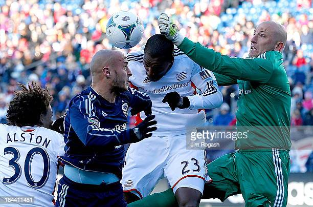 Matt Reis of New England Revolution makes a save with the help of teammate Jose Goncalves of New England Revolution on a ball that Aurelien Collin of...