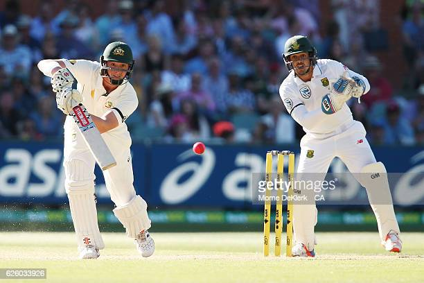 Matt Renshaw of Australia bats in front of Quinton de Kock of South Africa during day four of the Third Test match between Australia and South Africa...