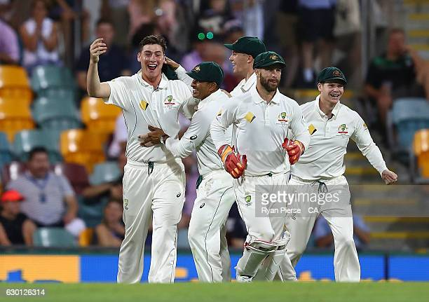 Matt Renshaw of Australia celebrates after taking a catch to dismiss Sami Aslam of Pakistanoff the bowling of Mitchell Starc of Australia during day...