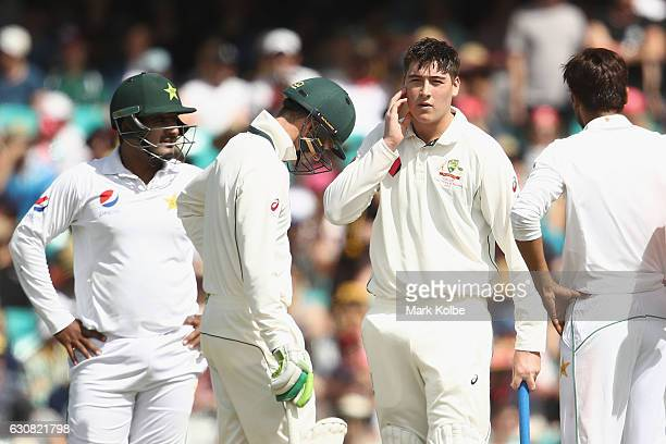 Matt Renshaw of Australia holds his jaw after being struck by a short ball while batting during day one of the Third Test match between Australia and...