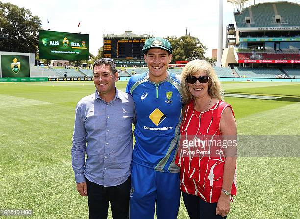 Matt Renshaw of Australia poses with his parents Ian and Alison Renshaw after recieving his Baggy Green Cap during day one of the Third Test match...