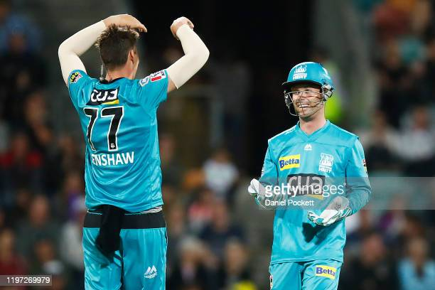 Matt Renshaw of the Heat celebrates with Jimmy Peirson of the Heat after dismissing D'Arcy Short of the Hurricanes during the Big Bash League match...