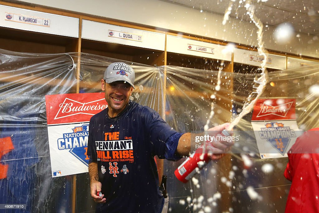 Matt Reynolds #56 of the New York Mets celebrates in the locker room with his teammates after defeating the Chicago Cubs in game four of the 2015 MLB National League Championship Series at Wrigley Field on October 21, 2015 in Chicago, Illinois. The Mets defeated the Cubs with a score of 8 to 3 to sweep the Championship Series.