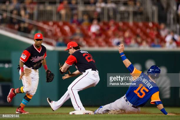 Matt Reynolds of the New York Mets is out at second base as Daniel Murphy of the Washington Nationals records the fielder's choice in the seventh...
