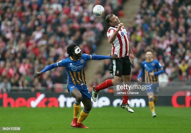 Matt Rhead of Lincoln City wins a header over Aristote Nsiala of Shrewsbury Town during the Checkatrade Trophy Final match between Shrewsbury Town...