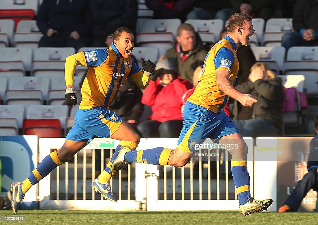 Matt Rhead of Mansfield Town celebrates after scoring his sides 3rd goal during the FA Cup with Budweiser Second Round match at Sincil Bank Stadium on December 1, 2012 in Lincoln, England.