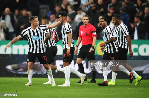Matt Ritchie congratulates Ayoze Perez of Newcastle United after he scores during the Premier League match between Newcastle United and Watford FC at...