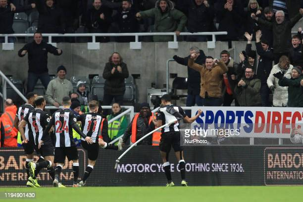 Matt Ritchie kicks the corner flag as Isaac Hayden of Newcastle United celebrates after scoring their winning goal during the Premier League match...