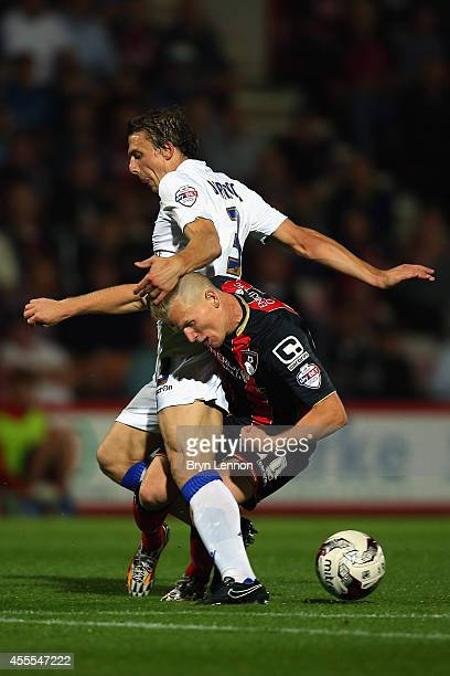 Matt Ritchie of AFC Bournemouth battles with Stephen Warnock of Leeds United during the Sky Bet Championship match between AFC Bournemouth and Leeds...