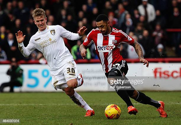 Matt Ritchie of AFC Bournemouth challenges Andre Gray of Brentford during the Sky Bet Championship match between Brentford and AFC Bournemouth at...