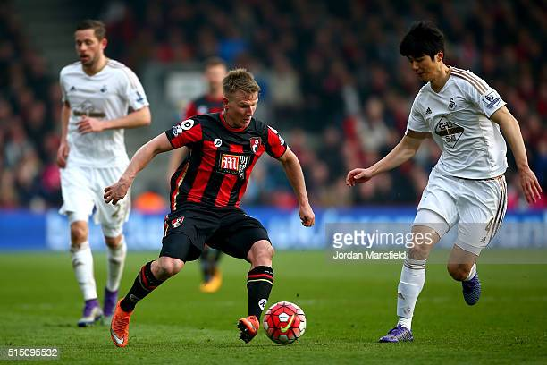 Matt Ritchie of Bournemouth and Ki SungYeung of Swansea City compete for the ball during the Barclays Premier League match between AFC Bournemouth...