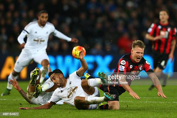 Matt Ritchie of Bournemouth and Neil Taylor of Swansea City compete for the ball during the Barclays Premier League match between Swansea City and...