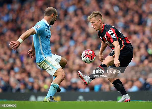 Matt Ritchie of Bournemouth and Pablo Zabaleta of Manchester City compete for the ball during the Barclays Premier League match between Manchester...