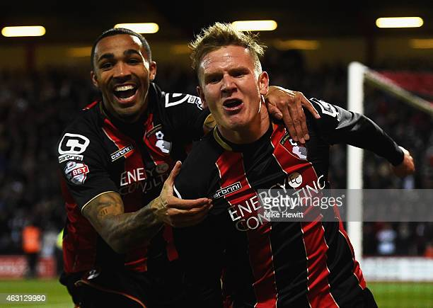 Matt Ritchie of Bournemouth celebrates with Callum Wilson as he scores their first goal during the Sky Bet Championship match between AFC Bournemouth...
