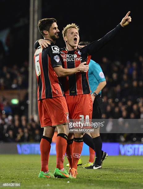 Matt Ritchie of Bournemouth celebrates with team mate Andrew Surman as he scores their fourth goal during the Sky Bet Championship match between...