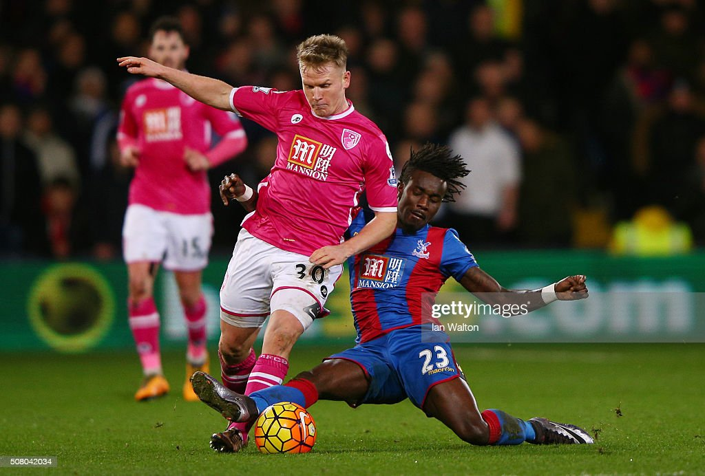 Matt Ritchie of Bournemouth is tackled by Pape N'Diaye Souare of Crystal Palace during the Barclays Premier League match between Crystal Palace and A.F.C. Bournemouth at Selhurst Park on February 2, 2016 in London, England.