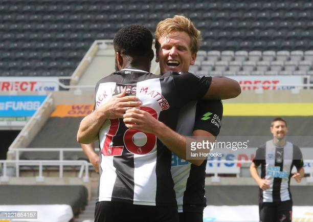 Matt Ritchie of Newcastle celebrates scoring the third goal with Danny Rose during the Premier League match between Newcastle United and Sheffield...