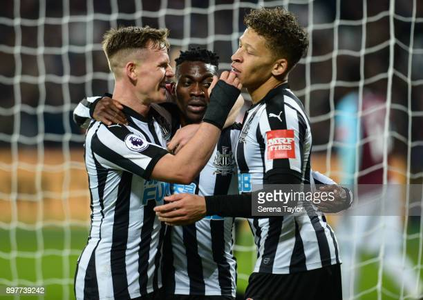Matt Ritchie of Newcastle United and Dwight Gayle celebrate with Christian Atsu after he scores Newcastle's third goal during the Premier League...
