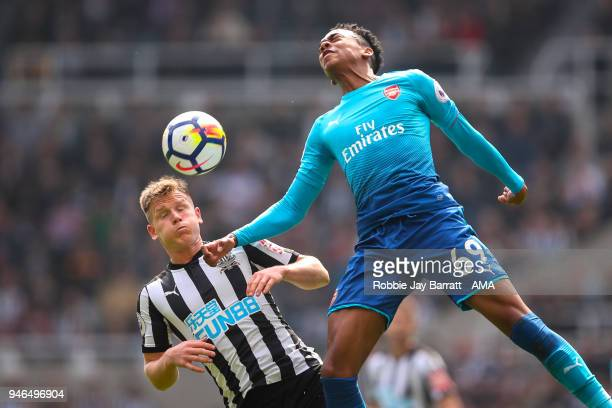 Matt Ritchie of Newcastle United and Joe Willock of Arsenal during the Premier League match between Newcastle United and Arsenal at St James Park on...