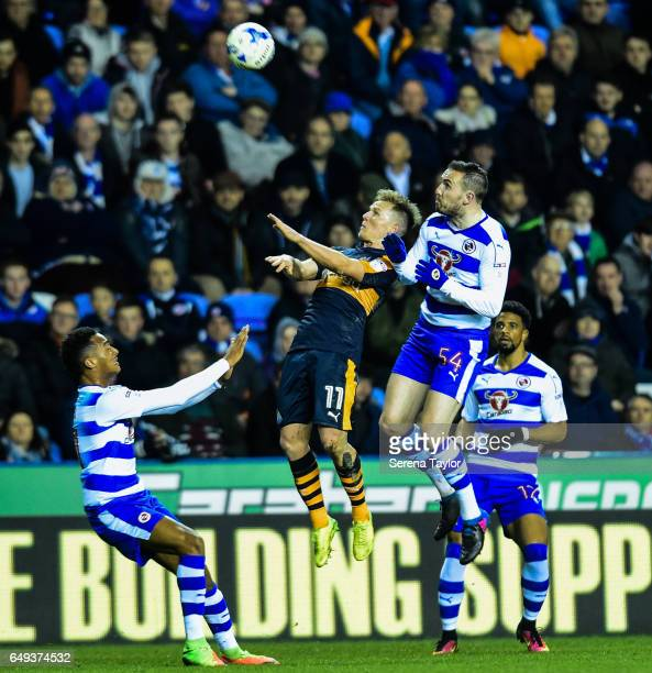 Matt Ritchie of Newcastle United and Jordon Mutch of Reading contest the ball during the Sky Bet Championship Match between Reading and Newcastle...