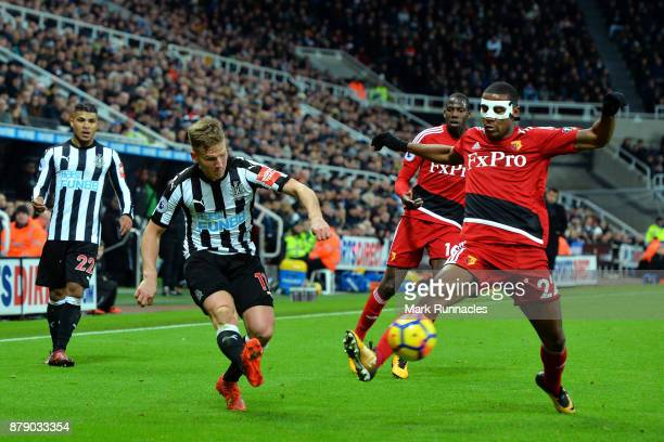 Matt Ritchie of Newcastle United and Marvin Zeegelaar of Watford battle for the ball during the Premier League match between Newcastle United and...
