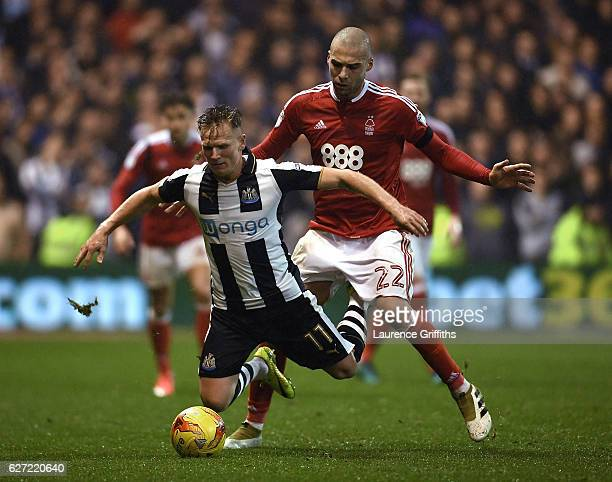 Matt Ritchie of Newcastle United and Pajtim Kasami of Nottingham Forest battle for the ball during the Sky Bet Championship match between Nottingham...