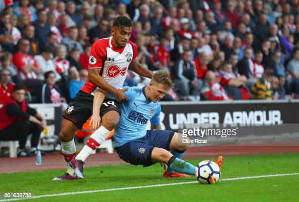 Matt Ritchie of Newcastle United and Sofiane Boufal of Southampton battle for the ball during the Premier League match between Southampton and...