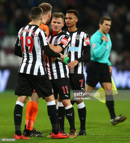 Matt Ritchie of Newcastle United and team mates celebrate after the final whistle during the Premier League match between West Ham United and...