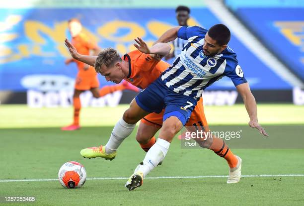 Matt Ritchie of Newcastle United battles for possession with Neal Maupay of Brighton and Hove Albion during the Premier League match between Brighton...