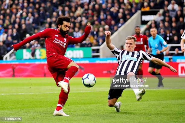 Matt Ritchie of Newcastle United blocks a shot from Mohamed Salah of Liverpool during the Premier League match between Newcastle United and Liverpool...