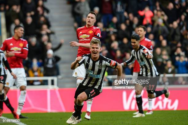Matt Ritchie of Newcastle United celebrates after he scores the opening goal during the Premier League match between Newcastle United and Manchester...