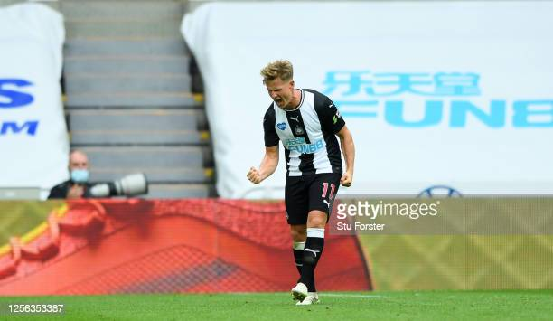 Matt Ritchie of Newcastle United celebrates after scoring his sides first goal during the Premier League match between Newcastle United and Tottenham...