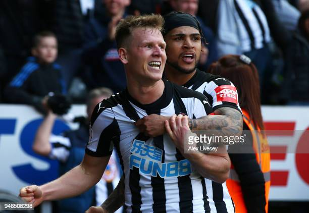 Matt Ritchie of Newcastle United celebrates after scoring his sides second goal with Deandre Yedlin of Newcastle United during the Premier League...