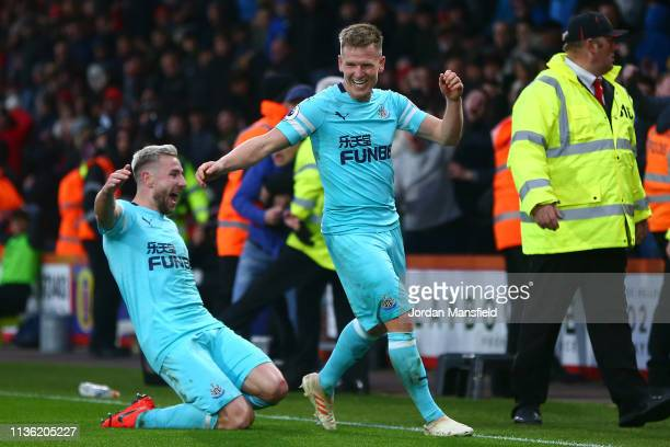 Matt Ritchie of Newcastle United celebrates after scoring his team's second goal with Paul Dummett of Newcastle United during the Premier League...