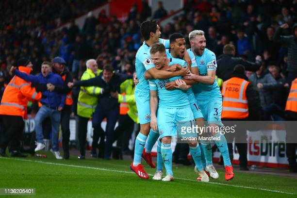 Matt Ritchie of Newcastle United celebrates after scoring his team's second goal with his team mates during the Premier League match between AFC...