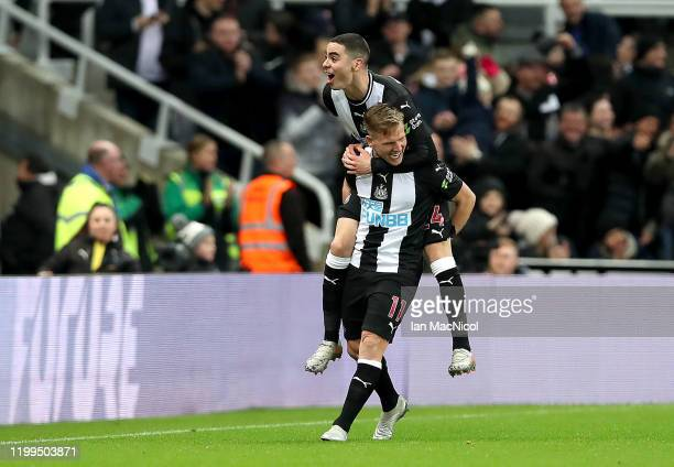 Matt Ritchie of Newcastle United celebrates his sides first goal with Miguel Almiron after a Eoghan O'Connell of Rochdale own goal during the FA Cup...