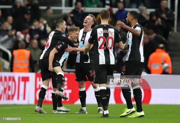 Matt Ritchie of Newcastle United celebrates his sides first goal with his team mates after a Eoghan O'Connell of Rochdale own goal during the FA Cup...