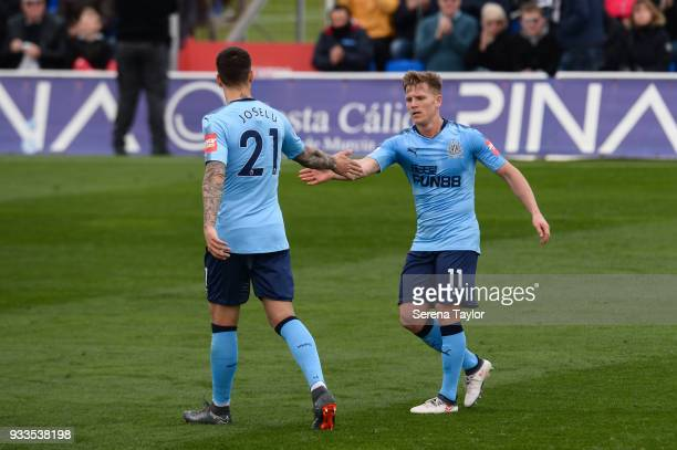 Matt Ritchie of Newcastle United celebrates with Joselu after scores the opening goal during the friendly match between Newcastle United and Royal...