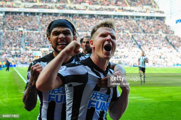 Matt Ritchie of Newcastle United celebrates with teammate DeAndre Yedlin after he scores Newcastle's second goal during the Premier League match...