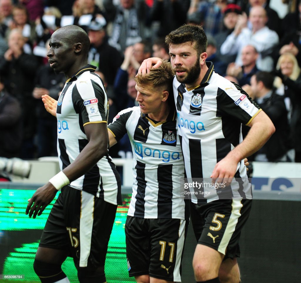 Matt Ritchie of Newcastle United (11) celebrates with teammates Mohamed Diame (L) and Grant Hanley (R) after scoring Newcastle's second goal during the Sky Bet Championship match between Newcastle United and Wigan Athletic at St.James' Park on April 1, 2017 in Newcastle upon Tyne, England.