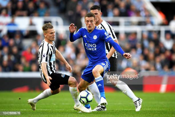 Matt Ritchie of Newcastle United challenges for the ball with Jamie Vardy of Leicester City during the Premier League match between Newcastle United...