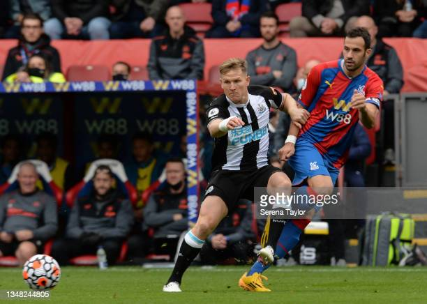 Matt Ritchie of Newcastle United FC and Luka Milivojevic of Crystal Palace during the Premier League match between Crystal Palace and Newcastle...