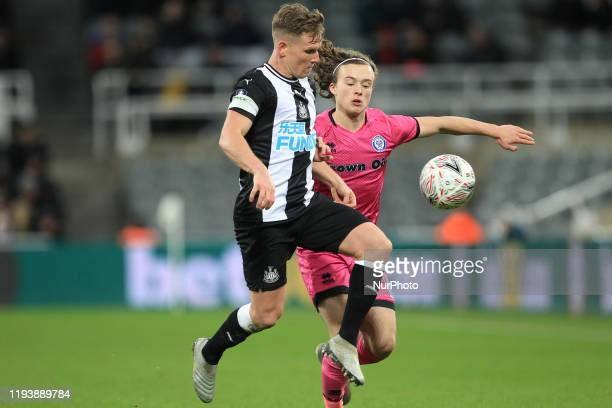 Matt Ritchie of Newcastle United in action with Luke Matheson of Rochdale during the FA Cup match between Newcastle United and Rochdale at St James's...