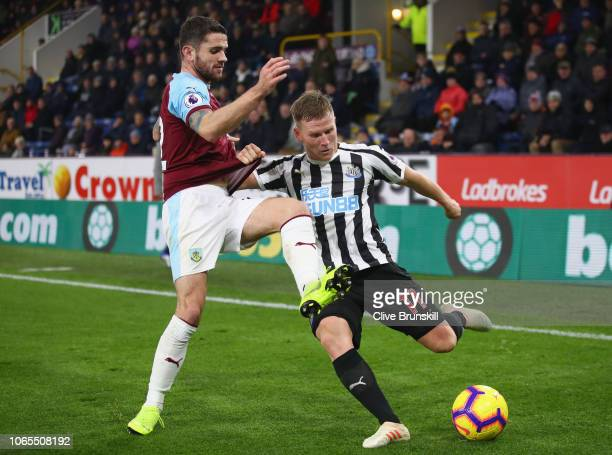 Matt Ritchie of Newcastle United is blocked by Robbie Brady of Burnley during the Premier League match between Burnley FC and Newcastle United at...