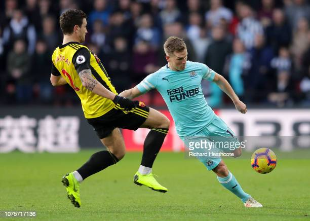 Matt Ritchie of Newcastle United is challenged by Daryl Janmaat of Watford during the Premier League match between Watford FC and Newcastle United at...