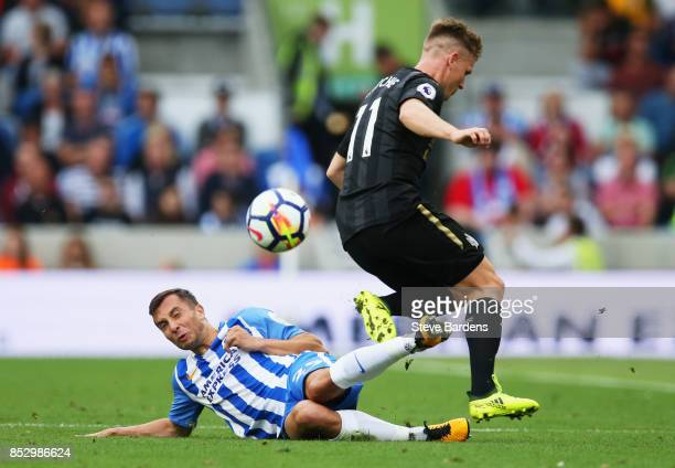 Matt Ritchie of Newcastle United is challenged by Markus Suttner of Brighton and Hove Albion during the Premier League match between Brighton and...