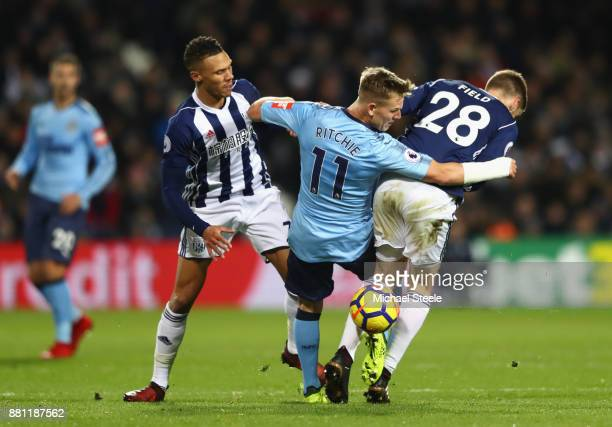Matt Ritchie of Newcastle United is tackled by Sam Field and Kieran Gibbs of West Bromwich Albion during the Premier League match between West...